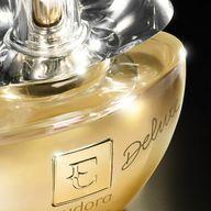 Eau de Parfum Deluxe é a luxuosa e exuberante fragrância de Eudora, que foi desenvolvida combinando a delicadeza das flores, toque adocicado do âmbar e a sofisticação das madeiras  Aproveite essa Seleção Especial e não perca a chance e economizar R$50,00💜✨  #PraCegoVer #PraTodosVerem: Na imagem vemos uma parte da fragrância Eudora EAU de Parfum na cor amarela em um fundo  degradê preto. #ahazoueudora #ahazourevenda